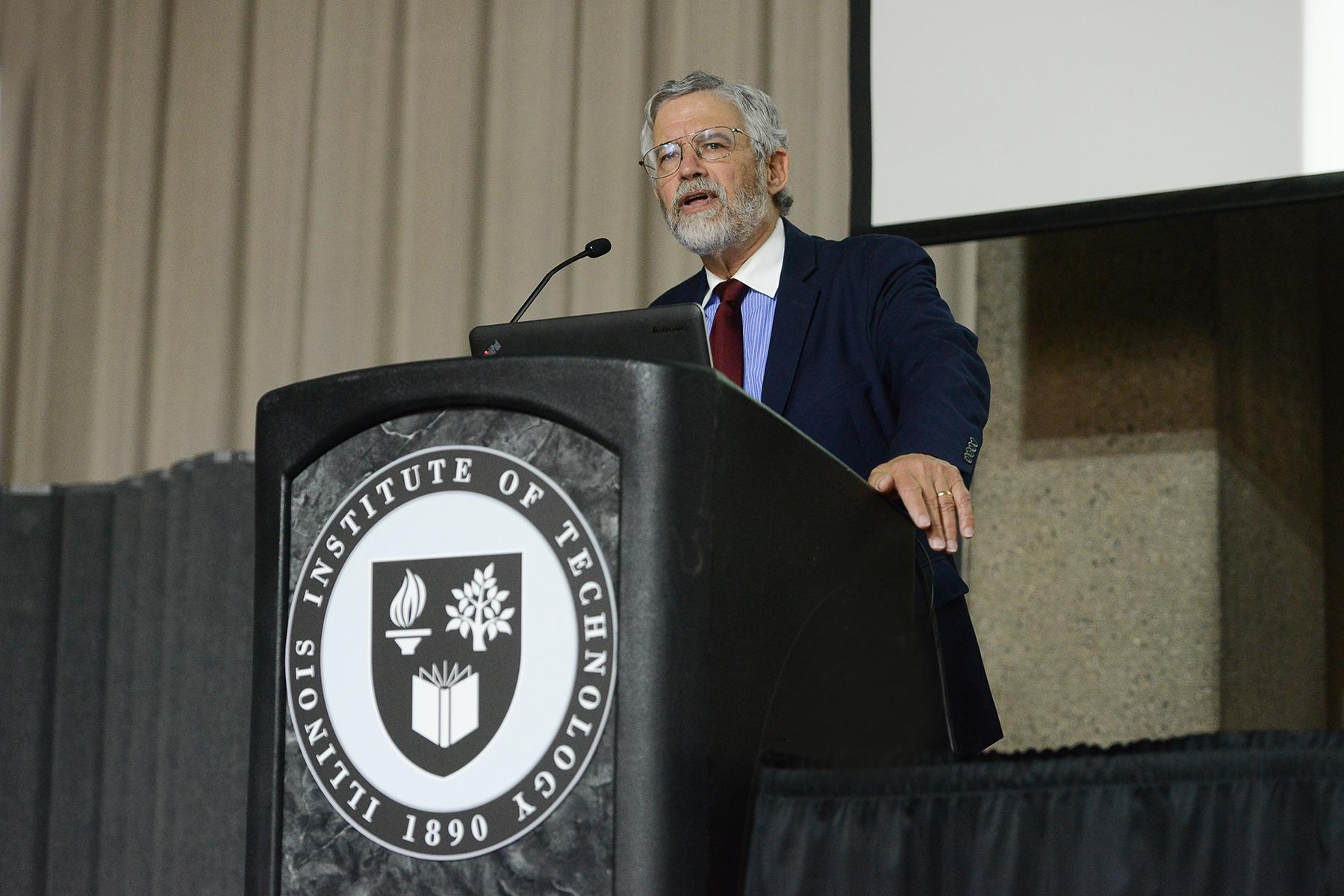 John P. Holdren, President Barack Obama's science and technology adviser from 2009-2017, gives a lecture on climate change Oct. 19 at the Illinois Institute of Technology. (Bonnie Robinson / Illinois Institute of Technology)