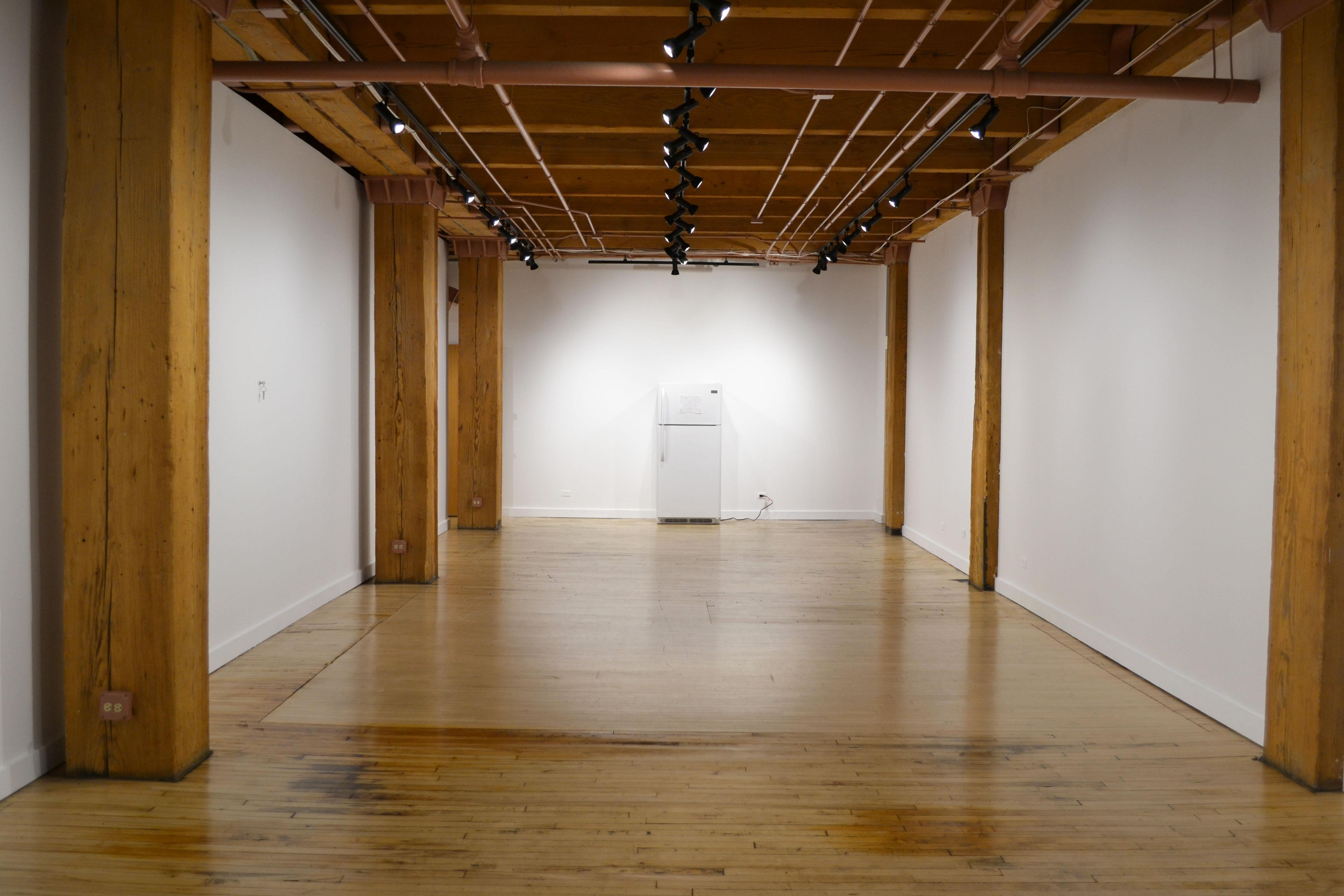 The minimalist exhibition at the Weinberg/Newton Gallery raises questions about representation in art and invites visitors to engage in the conversation surrounding homelessness. (Maya Miller / Chicago Tonight.)