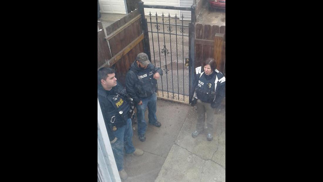 "Berto Aguayo says this photo shows ICE agents wearing gear that says ""police"" outside a home in Chicago the week of March 27. (Courtesy of Berto Aguayo)"