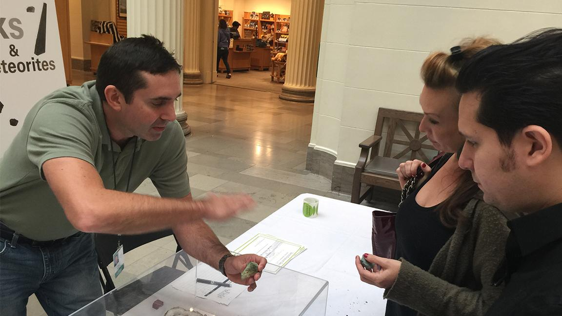 Jim Holstein, collections manager of geology at the Field Museum, examines a mineral at the museum's Identification Day in 2015. (Courtesy of the Field Museum)