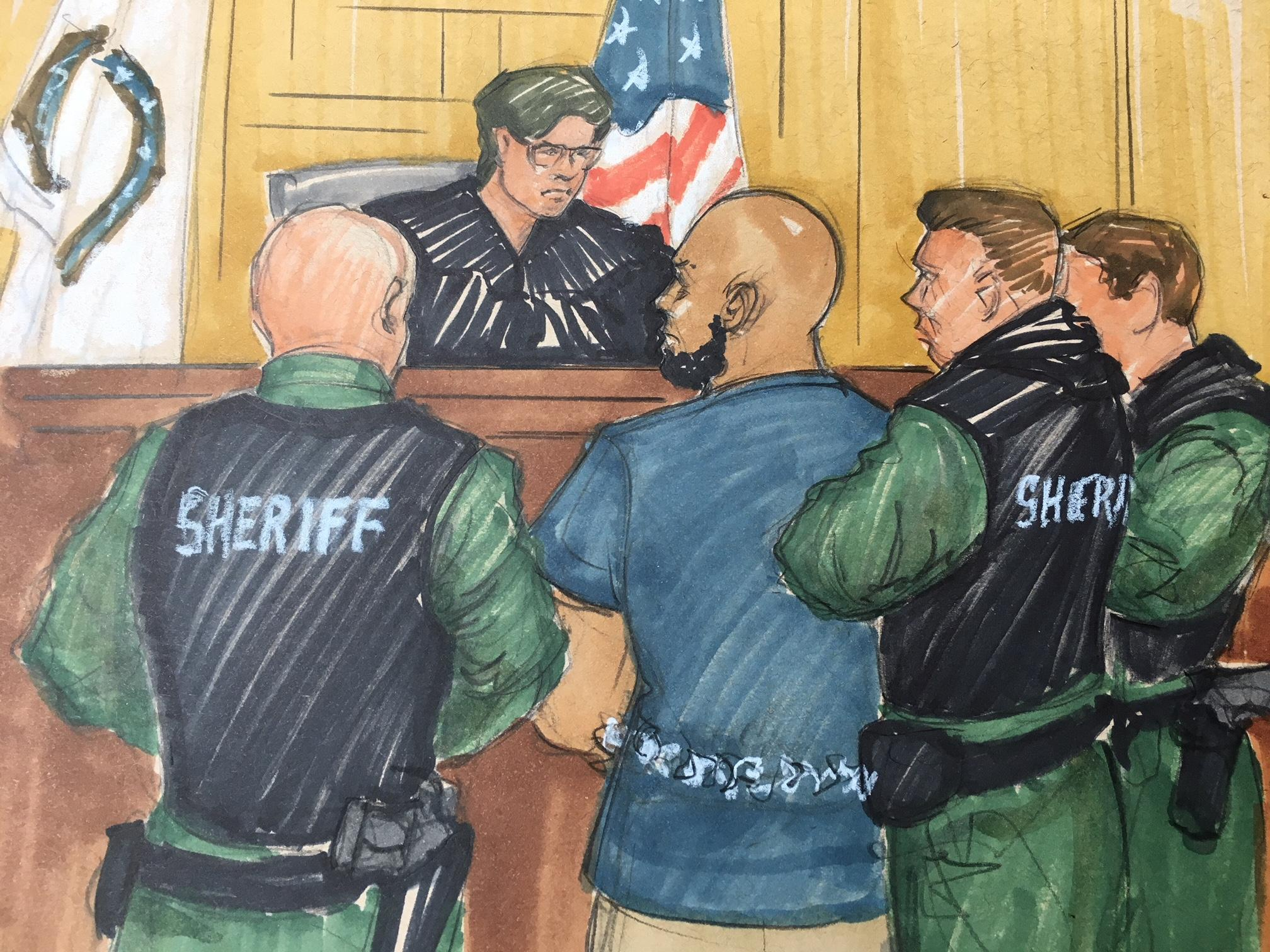 Shomari Legghette, 44, is flanked by a half-dozen heavily armored sheriff's deputies. (Thomas Gianni sketch)