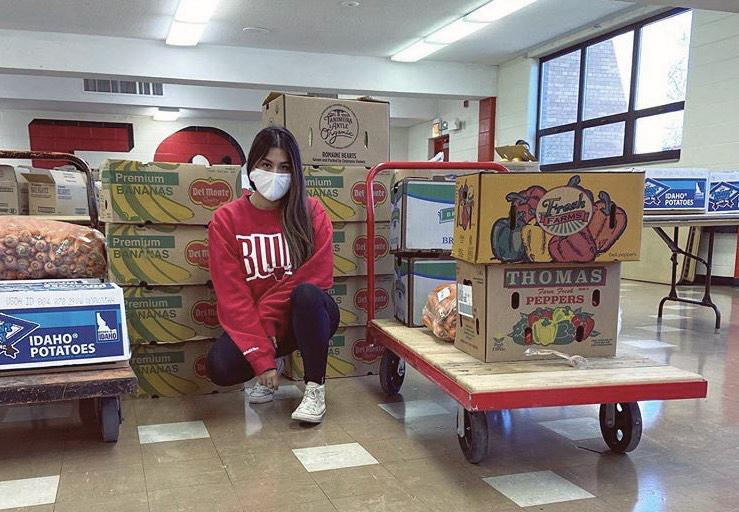 Elizabeth Morales, founder of Del Dia Chicago, sits with boxes of fresh produce she gets every week from farmers and grocery stores. (Courtesy Elizabeth Morales)