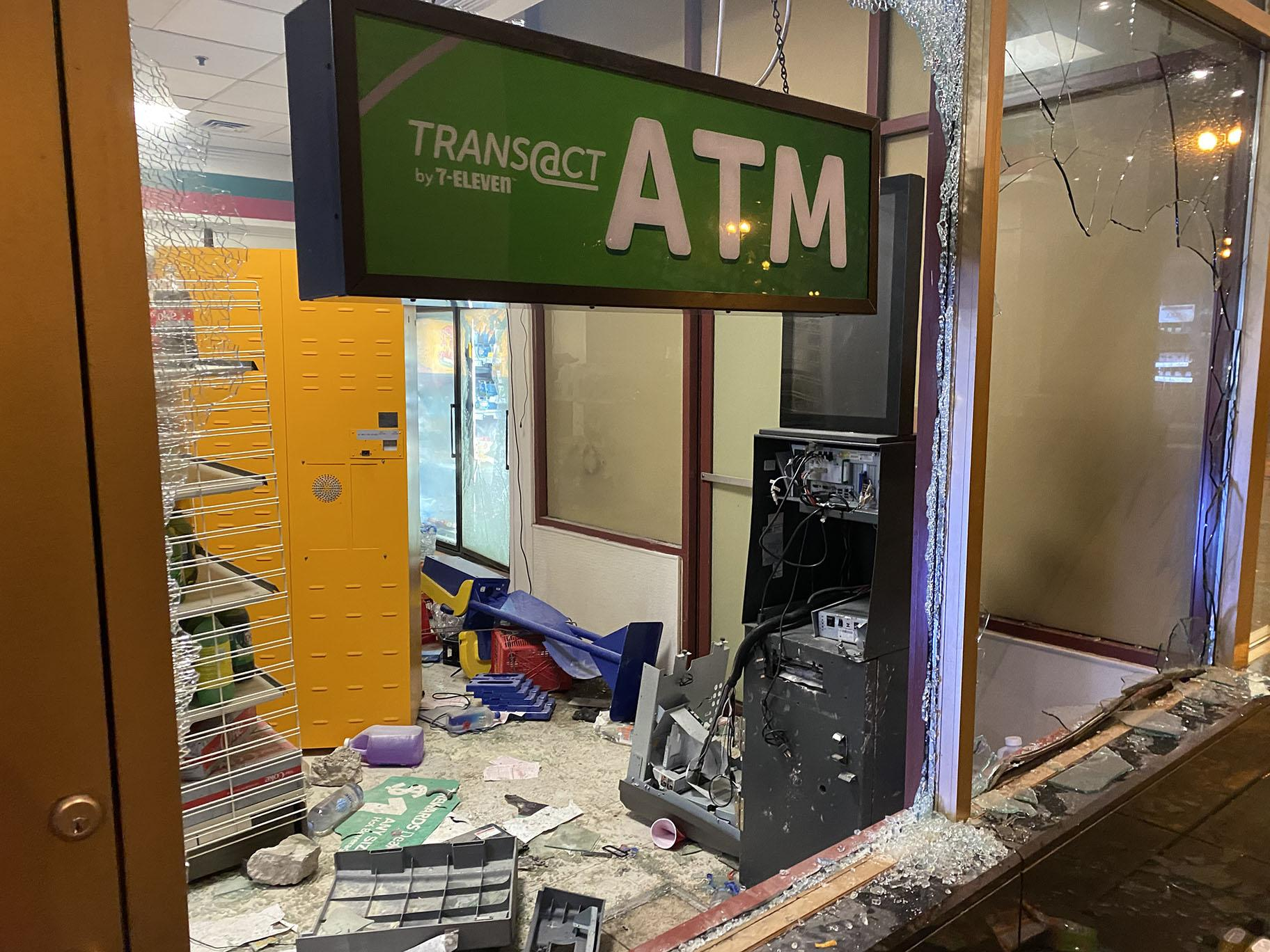 An ATM in the Loop is destroyed and windows are smashed on Saturday, May 30, 2020. (Hugo Balta / WTTW News)