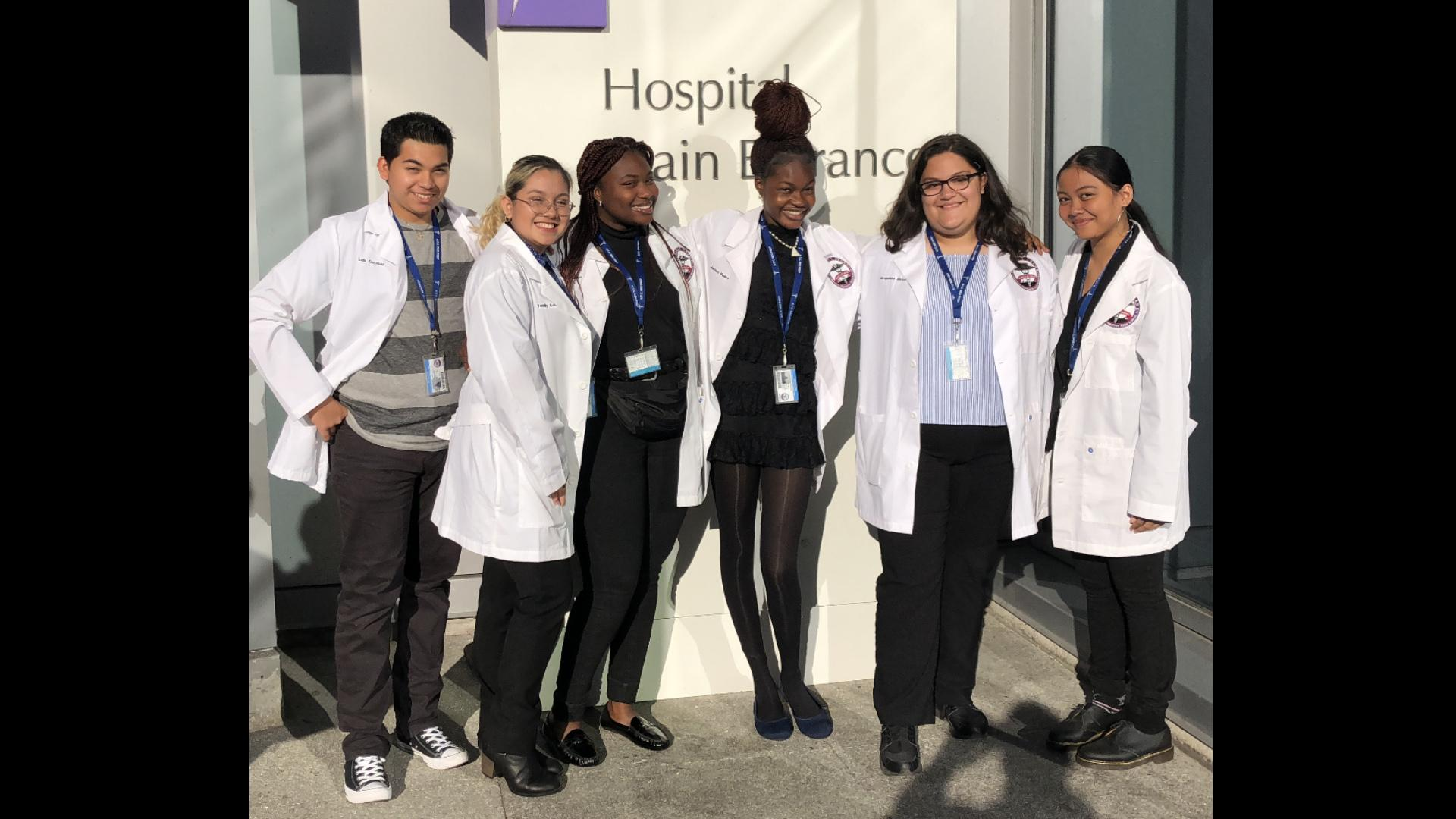 Chasity Kasir, far right, and her Health Occupations Students of America teammates had the opportunity to see a live open heart surgery. (Photo courtesy Chasity Kasir)