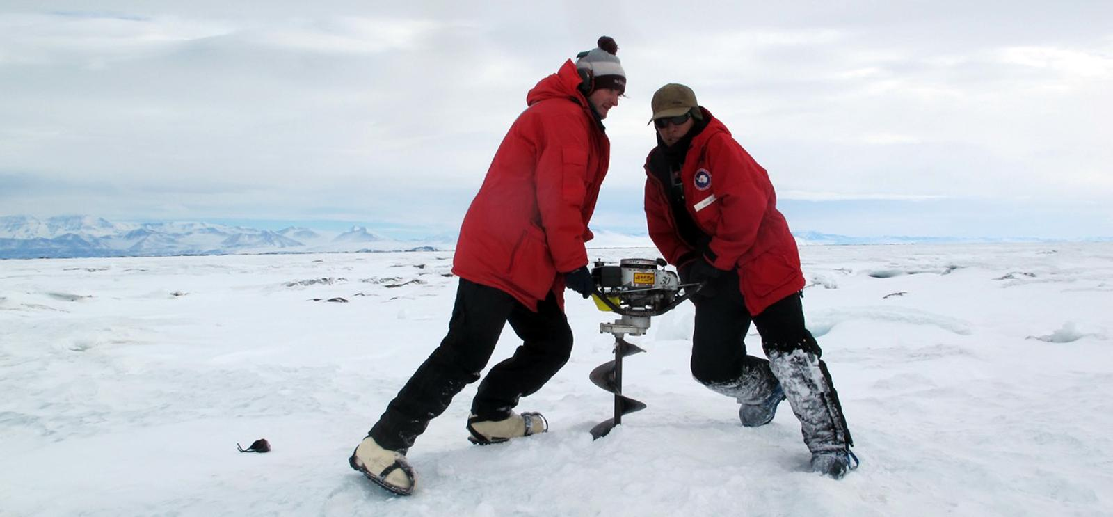 A University of Chicago graduate student works with a National Science Foundation collaborator to install a seismometer in an Antarctican ice shelf. (Doug MacAyeal / University of Chicago)