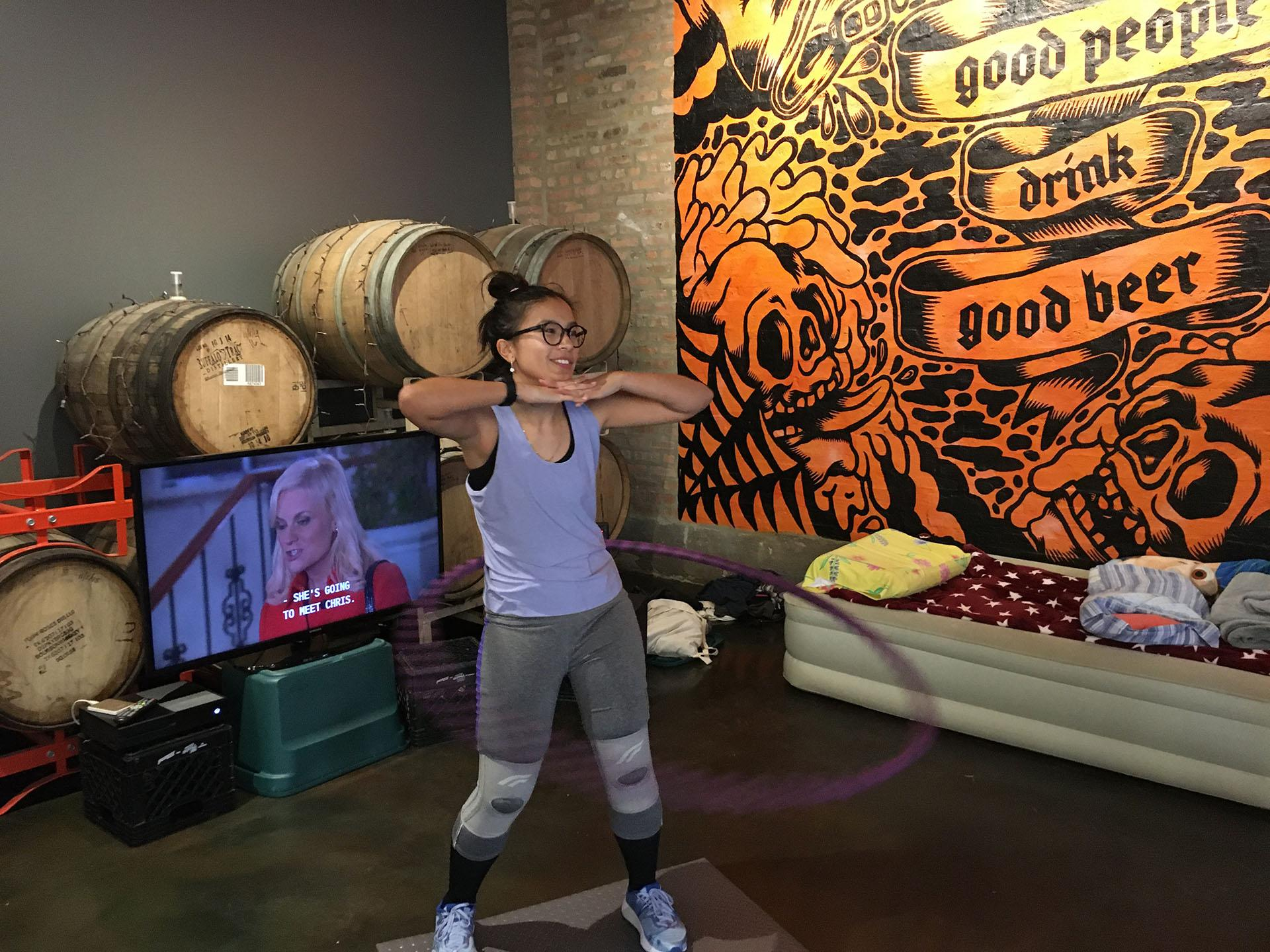 Wicker Park resident Jenny Doan poses for a picture Saturday, Nov. 23, 2019, as she nears the end of her Guinness World Record attempt for longest marathon hula-hooping session. (Kristen Thometz / WTTW News)