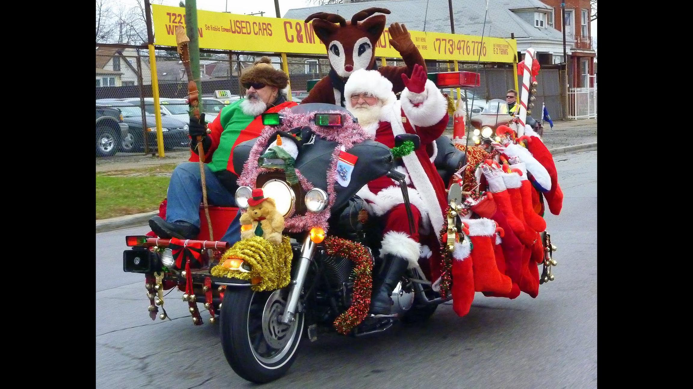 Santa swaps his sleigh for a motorcycle this weekend. Spot him along Western Avenue. (Jack Voss / Chicago Toys for Tots Motorcycle Parade)