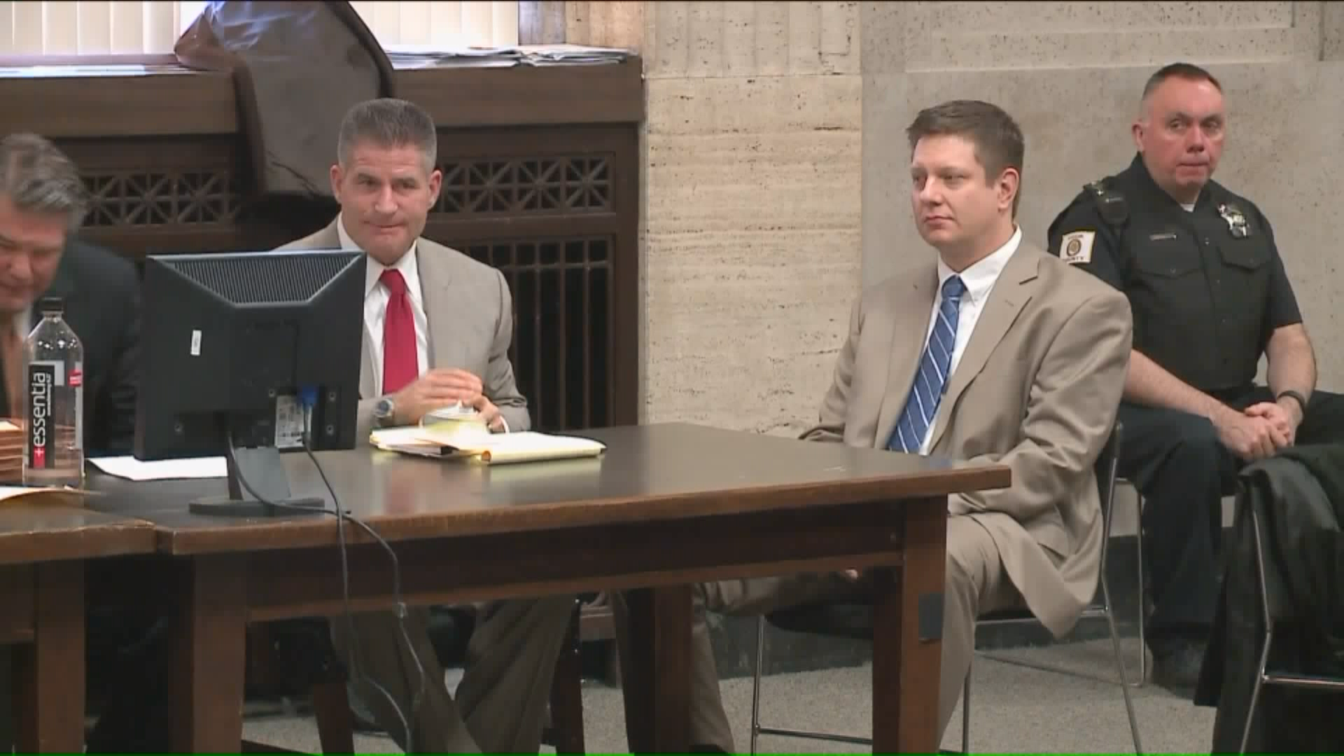 Former police officer Jason Van Dyke, right, is charged with murder in the shooting of Laquan McDonald. (Courtesy of WGN)