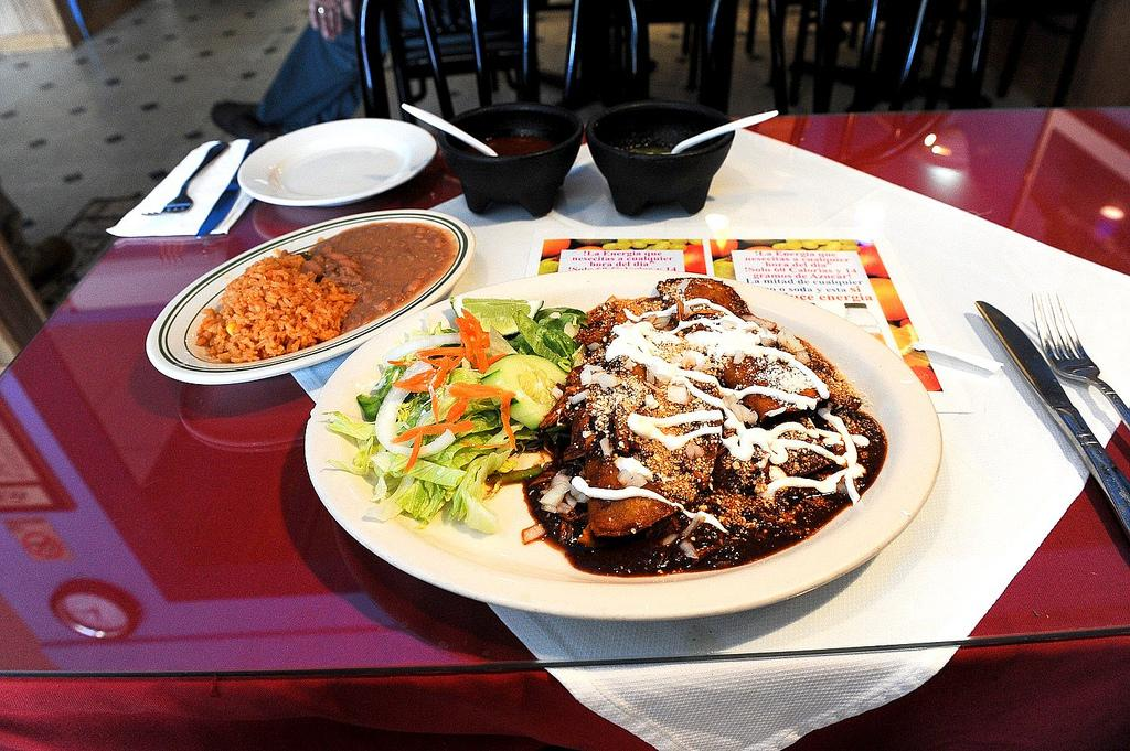 Chicken enchiladas with mole sauce is just one way the sauce is used in traditional Mexican cuisine. (Jazz Guy / Flickr)