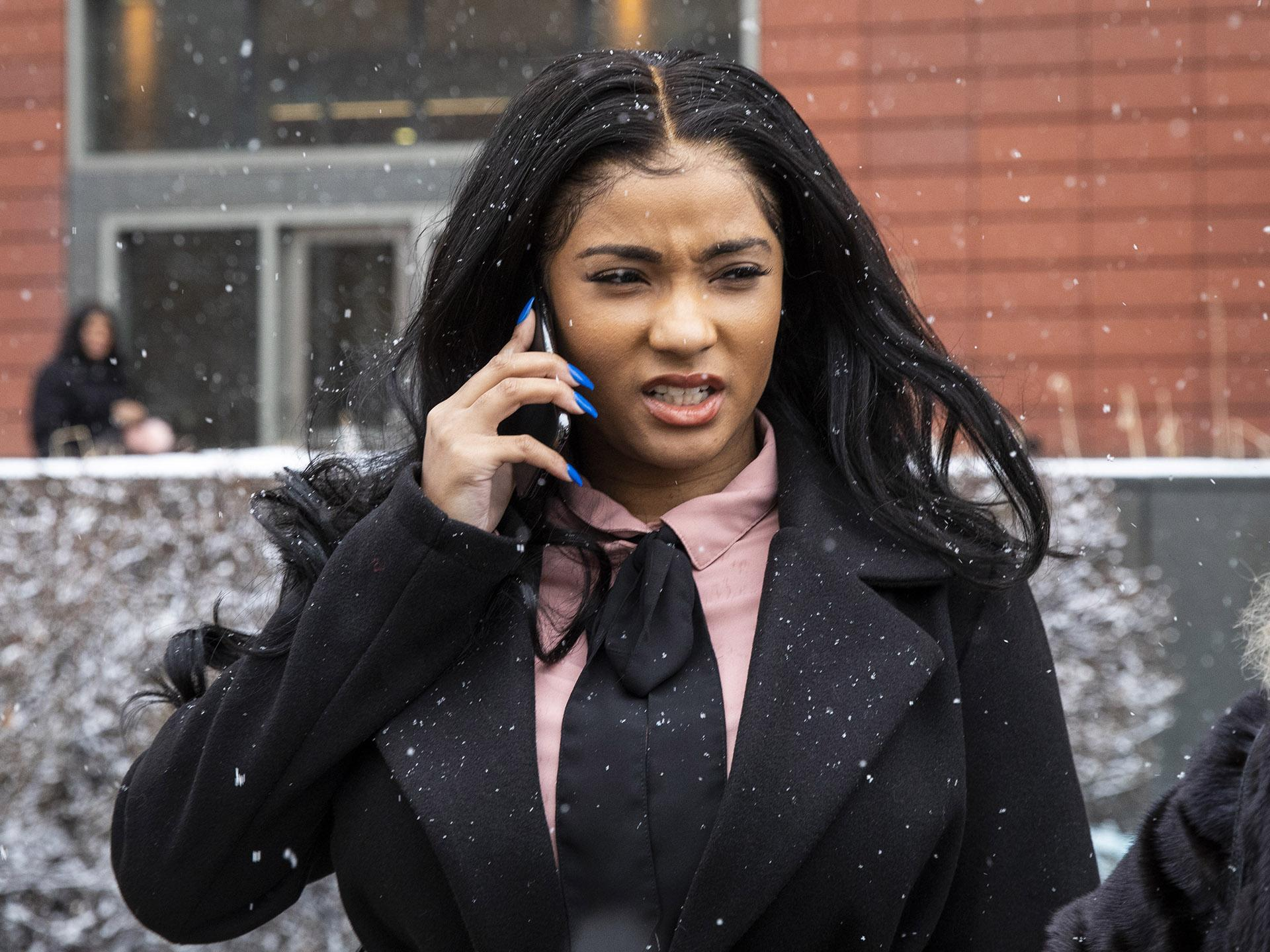 Joycelyn Savage, one of R&B singer R. Kelly's girlfriends, walks out of the Cook County Domestic Violence Courthouse, Thursday morning, Jan. 23, 2020, in Chicago. (Ashlee Rezin Garcia / Chicago Sun-Times via AP)