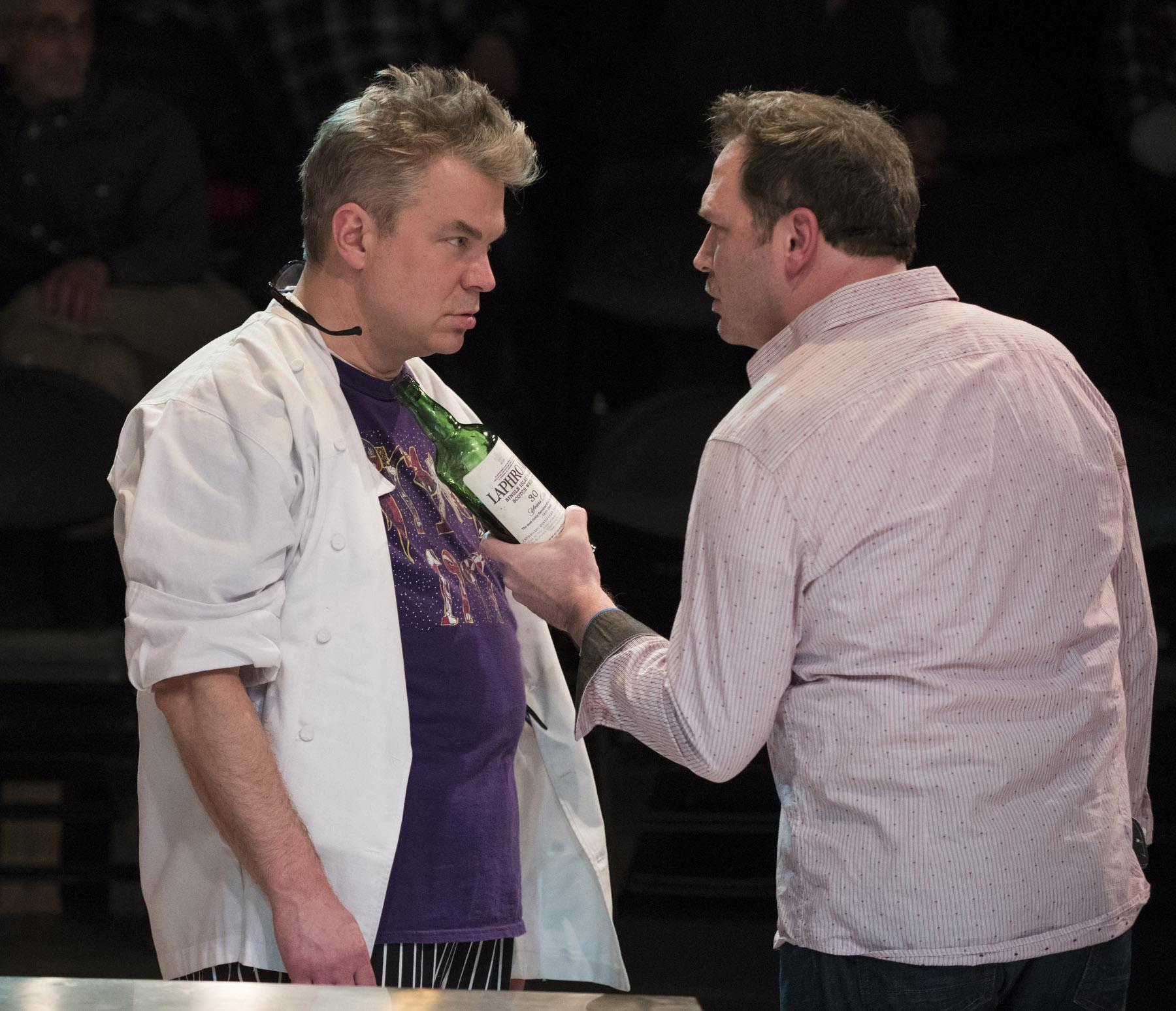 "Peter DeFaria, left, and Brad Woodard in ""How to Use a Knife."" (Photo by Michael Brosilow)"