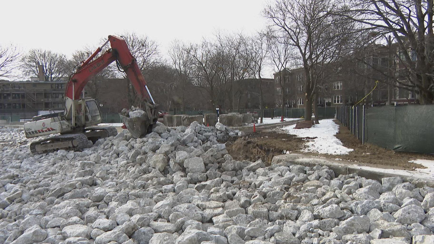 Boulders have replaced beaches along the lakefront, as part of the city's efforts to mitigate shoreline damage. (WTTW News)