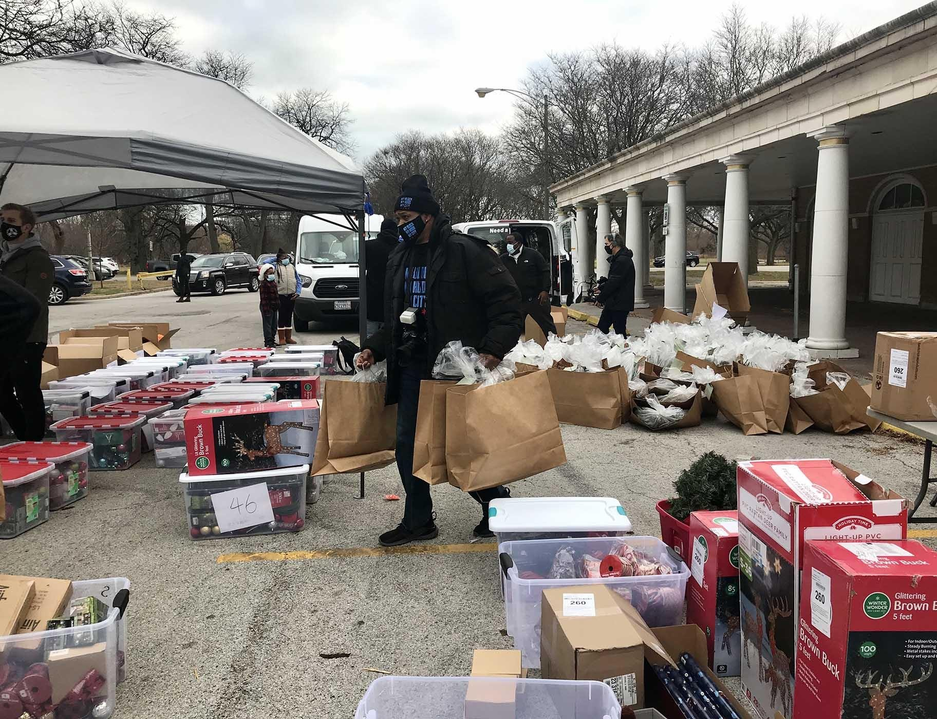 Volunteers distribute a mass of holiday lights, wreaths, ornaments and other decor. (Ariel Parrella-Aureli / WTTW News)