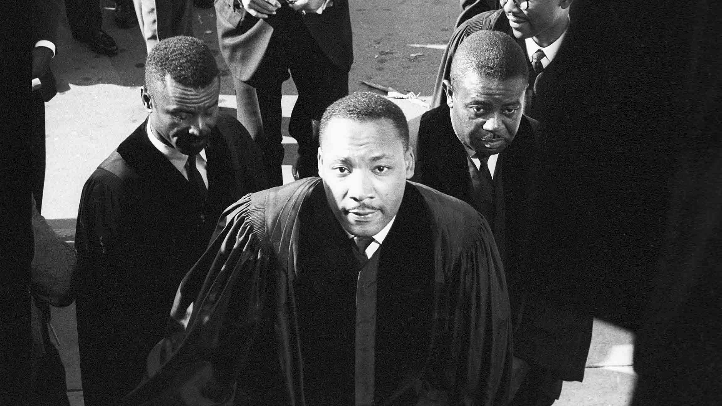 Civil Rights leaders Fred Shuttlesworth, left, Martin Luther King Jr., center, and Ralph Abernathy, right, attend a funeral for victims of the 16th Street Church bombing in Birmingham, Alabama. The Sept. 15, 1963 bombing killed four young African-American girls. (Chicago History Museum)