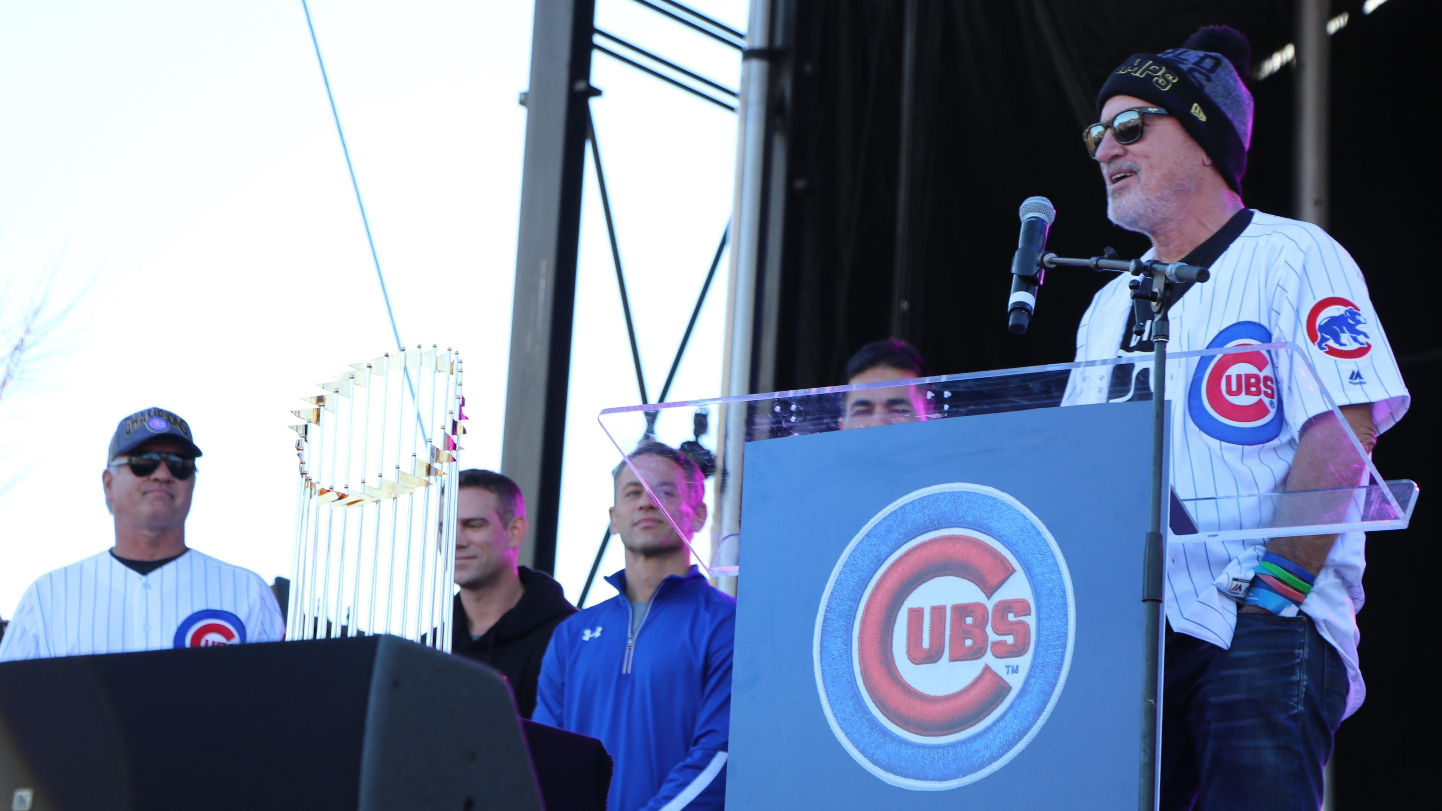 Chicago Cubs manager Joe Maddon, standing next to the Commissioner's Trophy, addresses the crowd in Grant Park on Nov. 4, 2016 during the team's World Series rally. (Evan Garcia / Chicago Tonight)