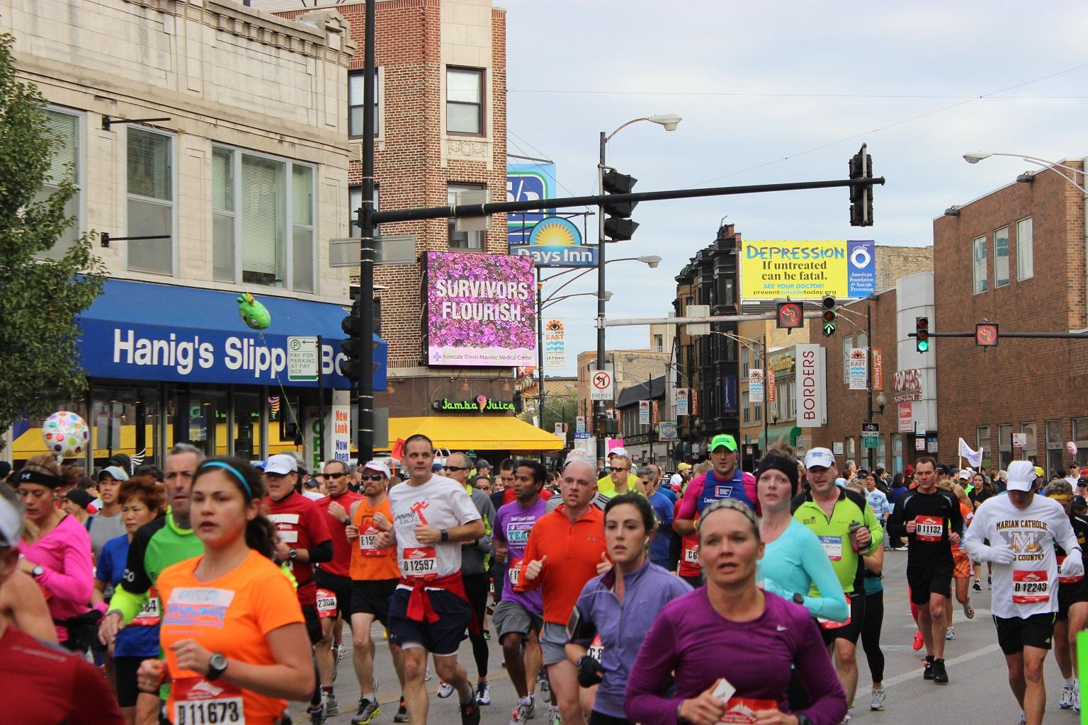 Runners participate in the 2012 Chicago Marathon near the intersection of Clark Street and Diversey Parkway. (Benjamin Lipsman / Flickr)