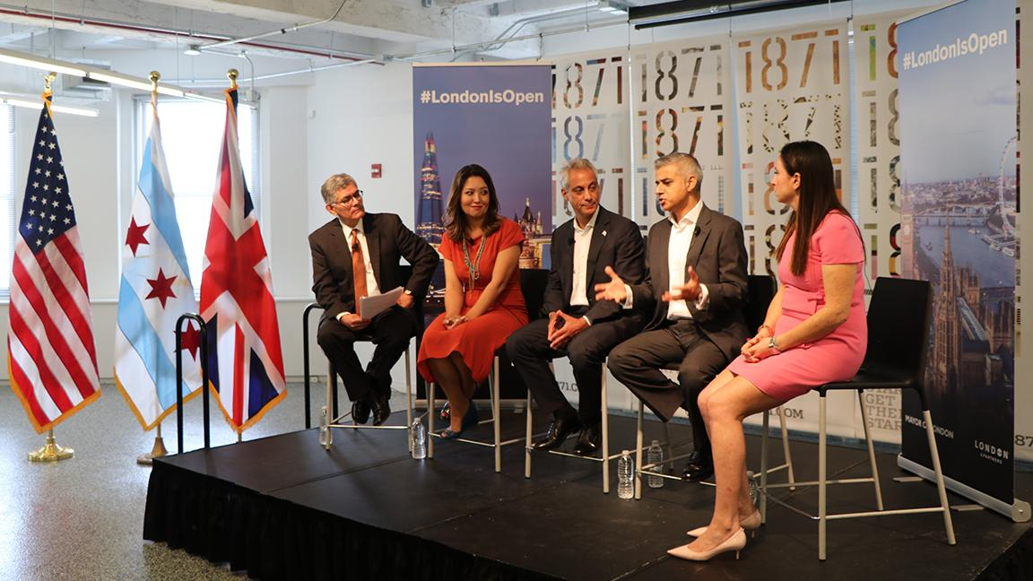 """Chicago Tonight"" host Phil Ponce moderates a panel discussion at 1871 with Mayor of London Sadiq Khan, Chicago Mayor Rahm Emanuel, and Rumi Morales, left, executive director of invest company CME Ventures, and U.K. entrepreneur Emma Sinclair, right. (Evan Garcia / Chicago Tonight)"