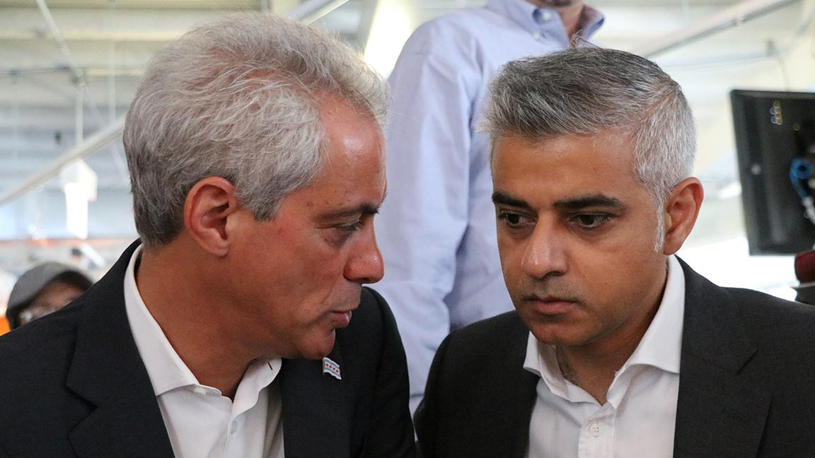 Chicago Mayor Rahm Emanuel speaks with Sadiq Khan, Mayor of London, after a panel discussion at tech hub 1871. (Evan Garcia / Chicago Tonight)