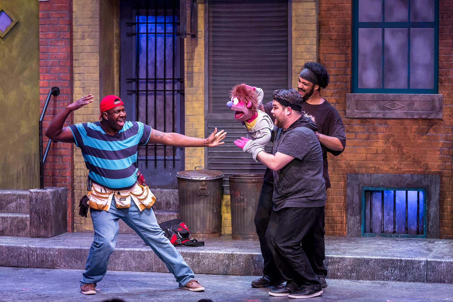 "David S. Robbins, Dan Smeriglio and Jonah D. Winston in ""Avenue Q"" at Mercury Theater. (Credit: Brett A. Beiner)"
