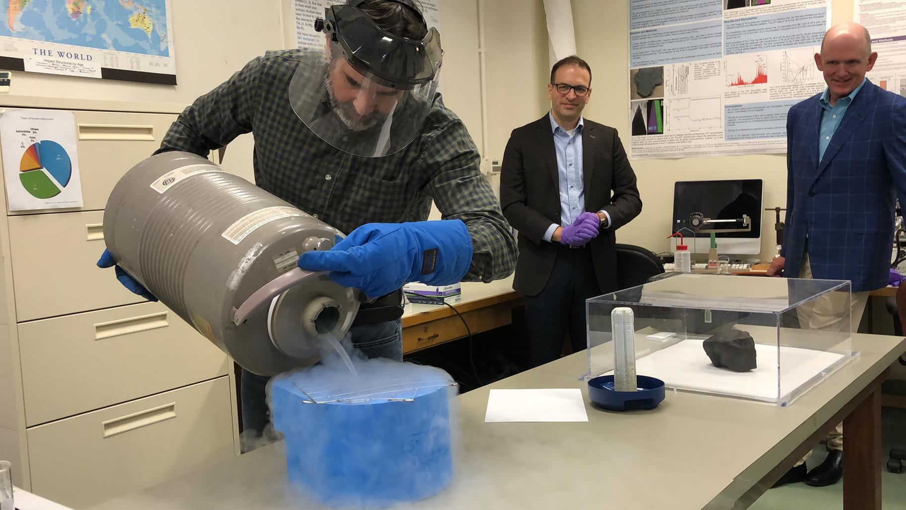 The Field Museum's Jim Holstein shows how the meteorite will be stored and preserved using liquid nitrogen cooled to negative 320 degrees Fahrenheit. (Alex Ruppenthal / WTTW News)
