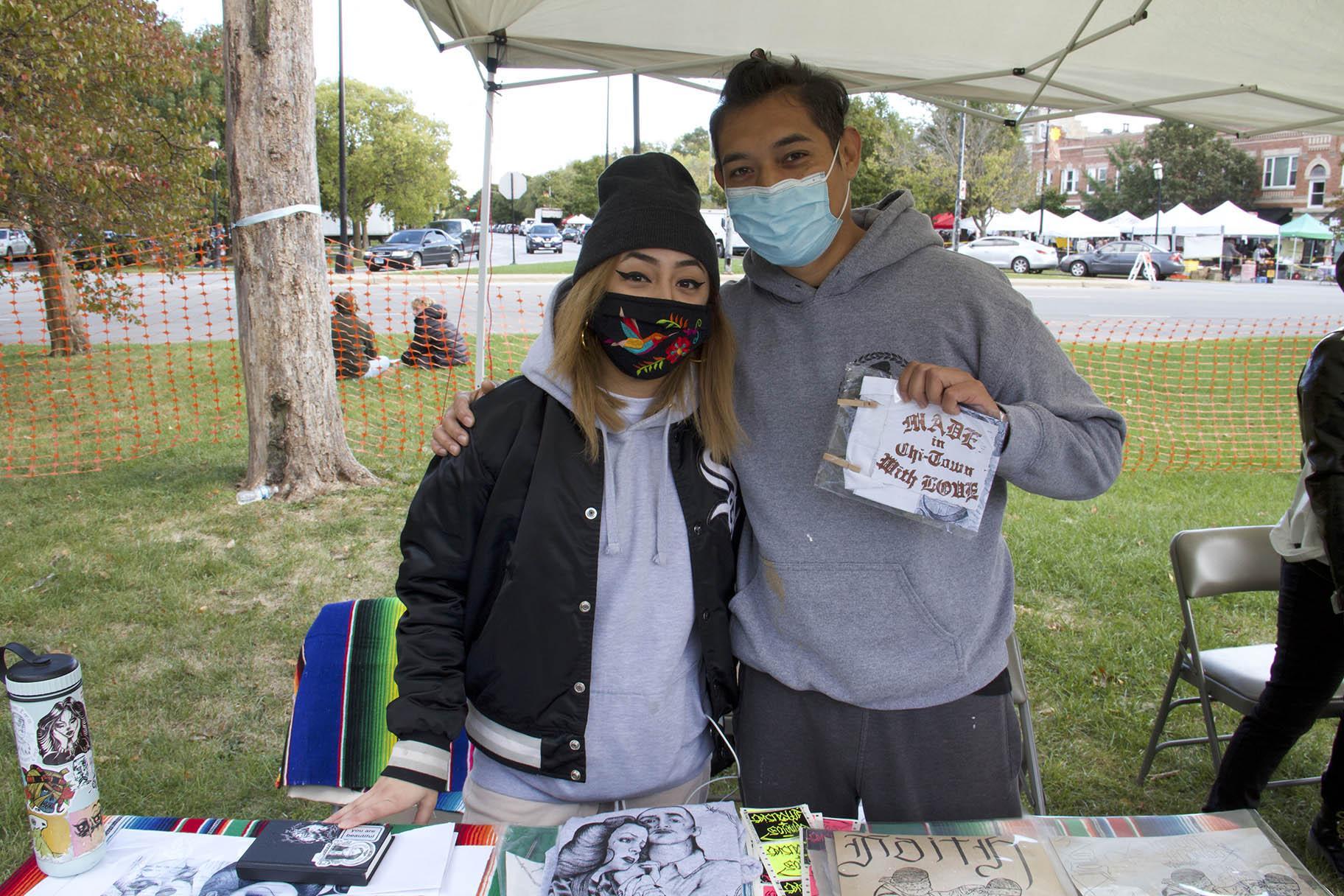 Artists Michelle Vega and Sir Charles at Zinemercado in Logan Square on Sunday, Oct. 4, 2020. (Ariel Parrella-Aureli / WTTW News)