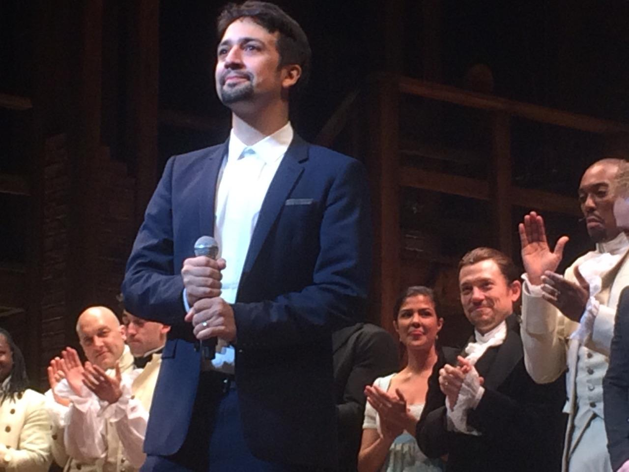 "Lin-Manuel Miranda appears on stage at the opening night of ""Hamilton"" in Chicago on Oct. 19. Actor Miguel Cervantes appears in the background, at right, in black. (Marc Vitali / Chicago Tonight)"