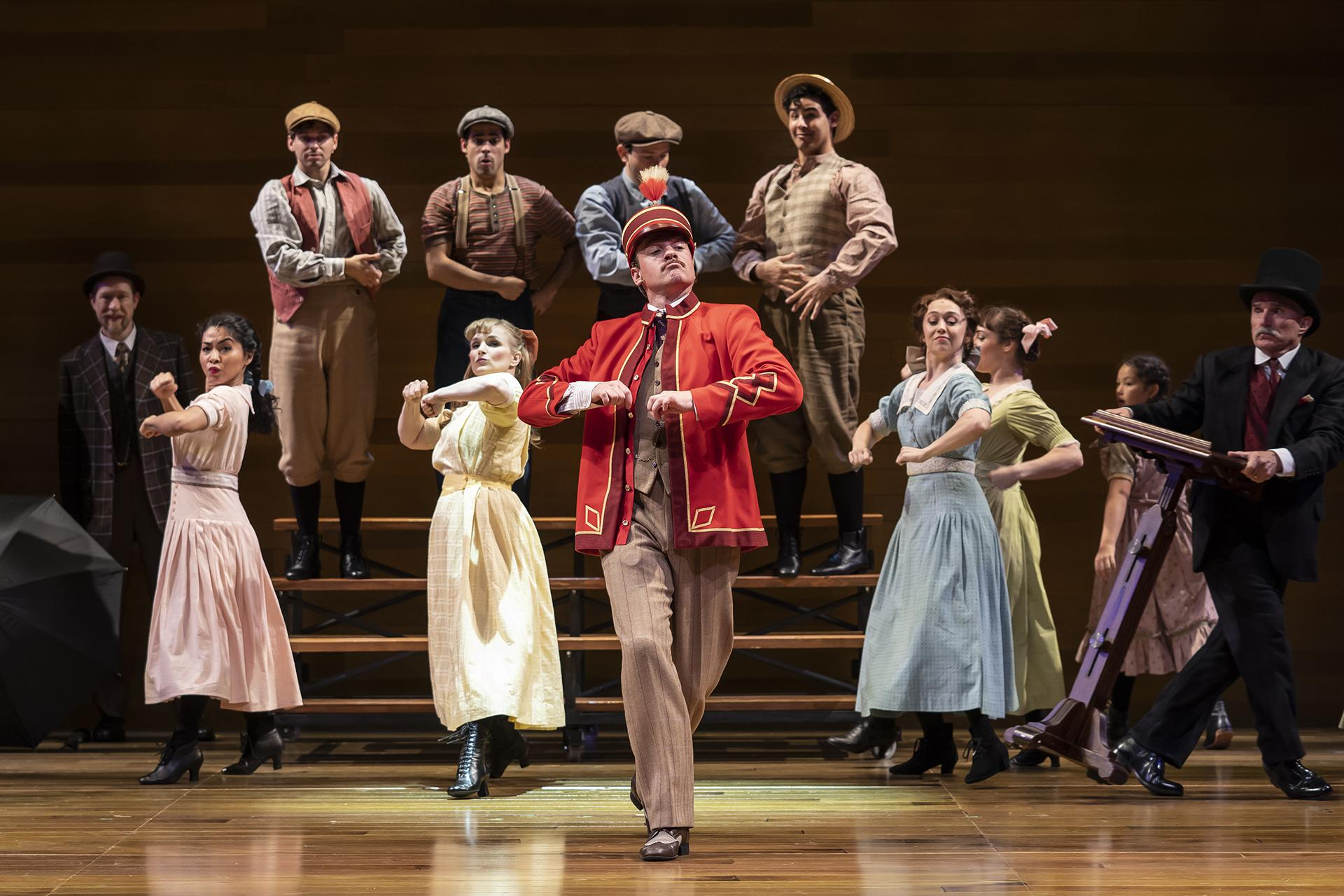 "James Konicek, Ayana Strutz, Matt Casey, Tommy Rivera-Vega, Kelly Felthous, Christopher Kale Jones, Geoff Packard, Alejandro Fonseca, Laura Savage, Adrienne Velasco-Storrs, Sophie Ackerman and Ron E. Rains in ""The Music Man"" at the Goodman Theatre. (Photo by Liz Lauren)"