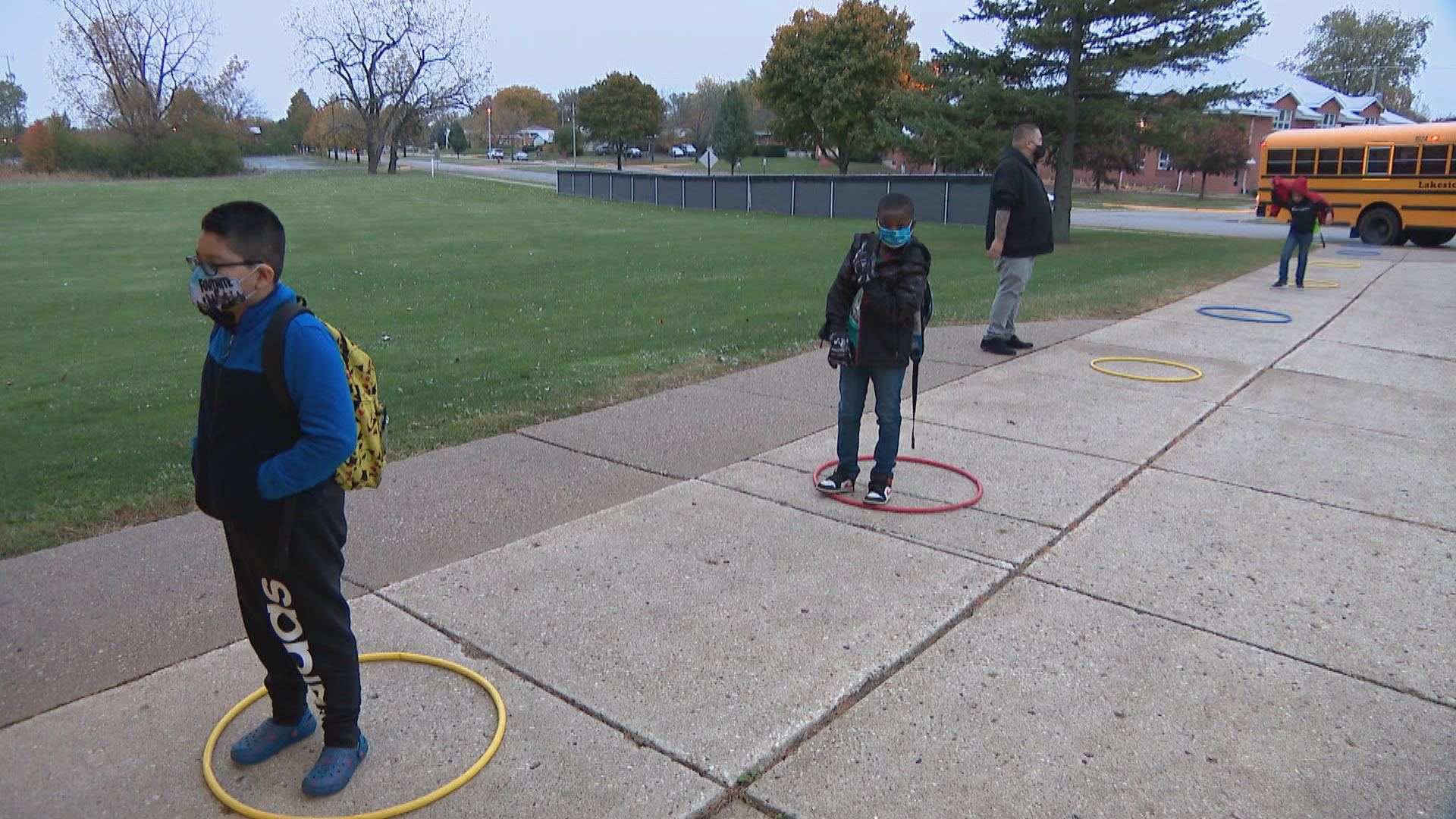 Elementary school students stay socially distanced while lining up to enter A.J. Katenzmaier Academy in North Chicago on Oct. 30, 2020. (WTTW News)