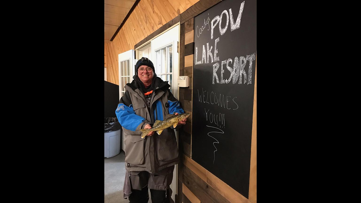 Jan Michalets poses for a photo with her catch at the Coadys' Point of View Lake Resort in Wisconsin. (Courtesy Genevieve Coady)