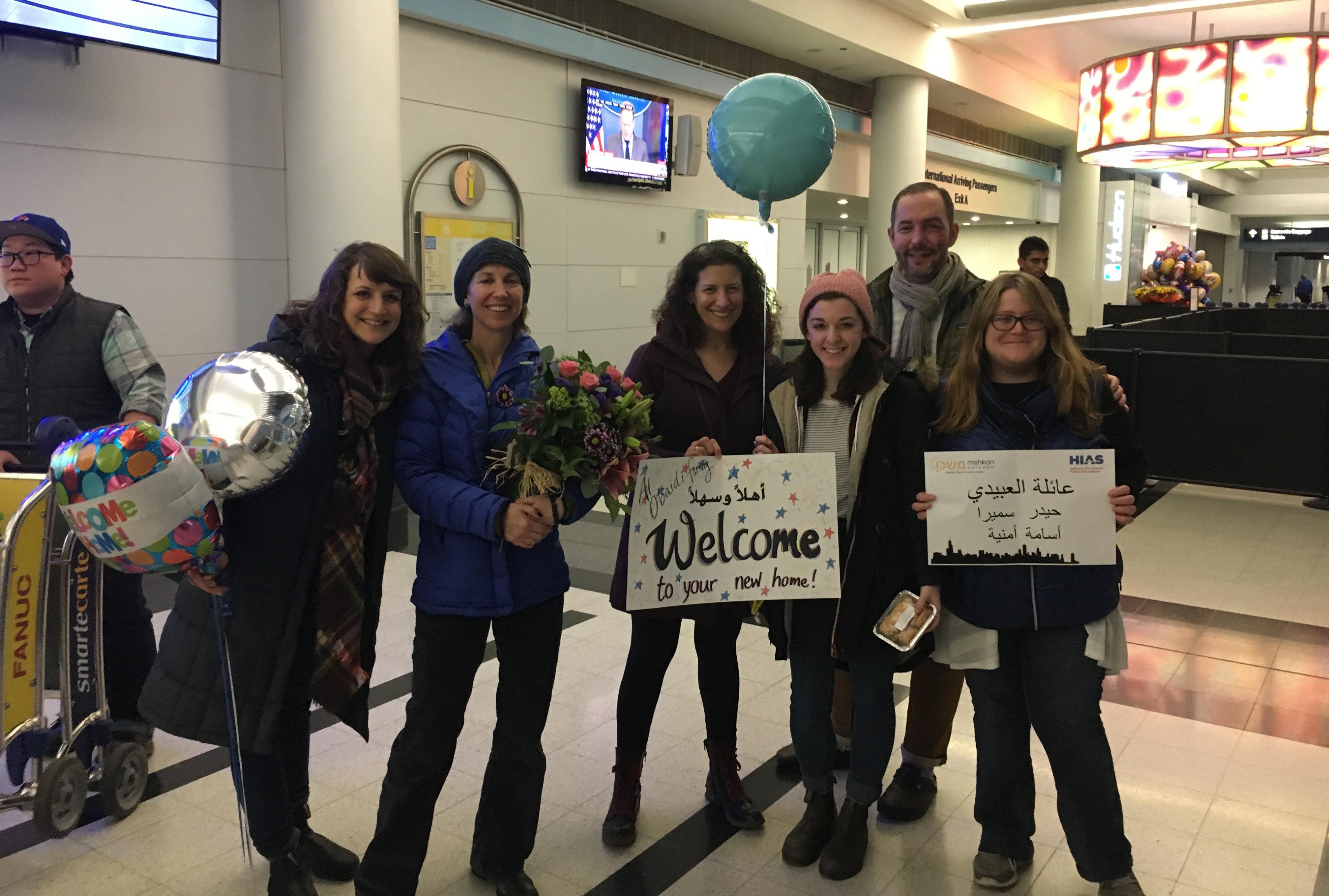 Members of Mishkan Chicago wait for the Al-Obaidis to arrive at O'hare on Jan. 24.