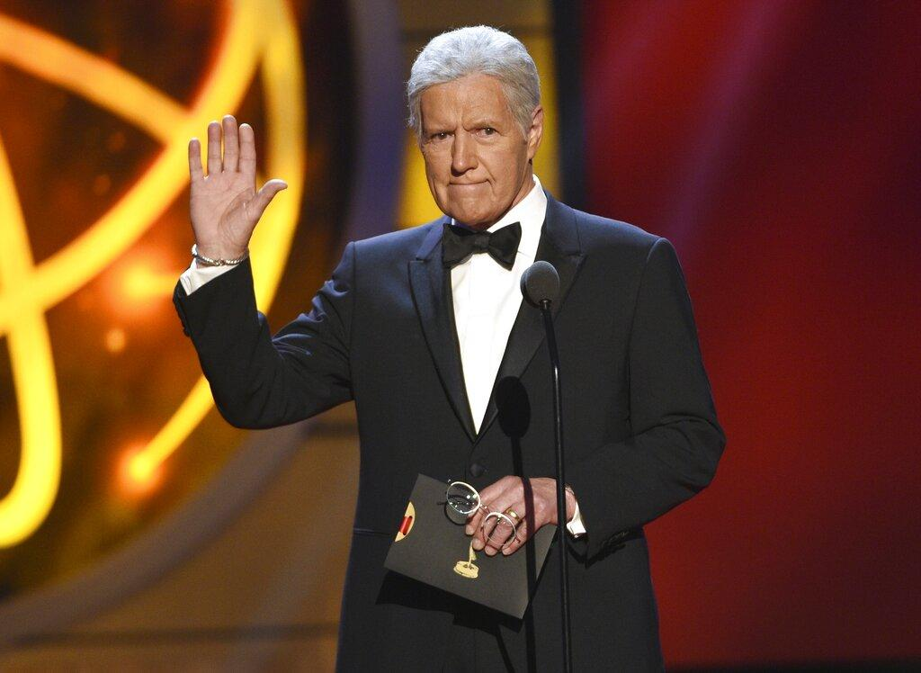 This May 5, 2019, file photo shows Alex Trebek gestures while presenting an award at the 46th annual Daytime Emmy Awards in Pasadena, Calif. (Photo by Chris Pizzello / Invision / AP, File)