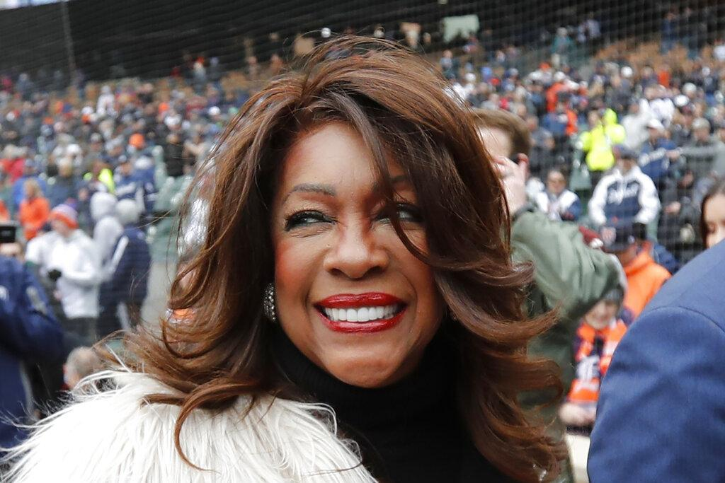 In this April 4, 2019, file photo, Mary Wilson, a former member of The Supremes, is escorted after singing the national anthem before a baseball game between the Detroit Tigers and the Kansas City Royals in Detroit. (AP Photo / Carlos Osorio, File)
