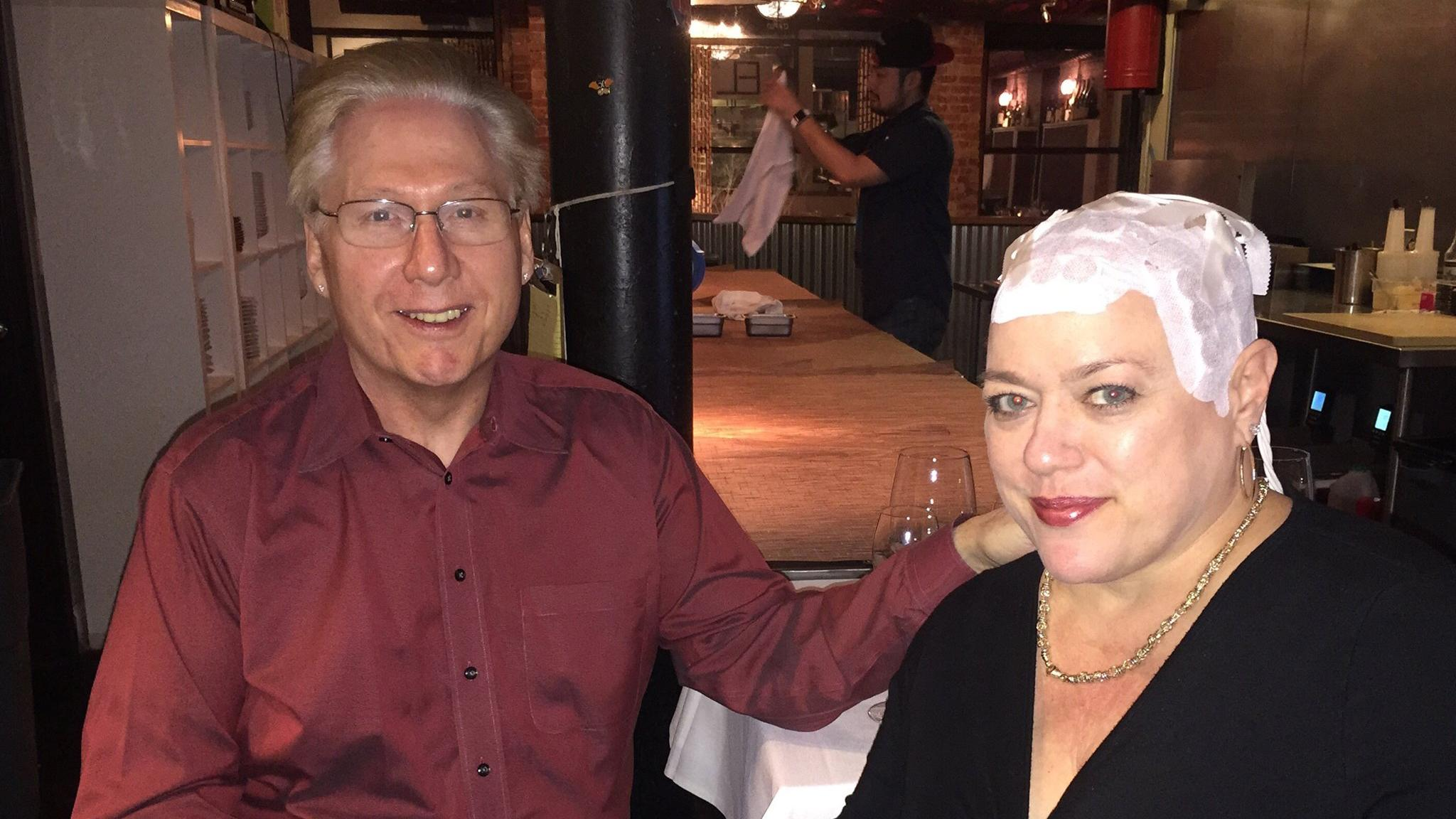 """I never cover it. I do put a light color hat on it to keep the sun off of it but I don't wear a wig or cap every day,"" said Joyce Endresen, who was diagnosed with glioblastoma and uses a skull-worn electric fields cap while dining at a restaurant with her husband, Hal. (Courtesy Joyce Endresen)"