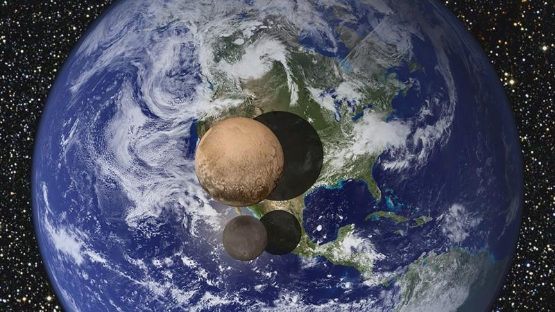 Graphic of Pluto and its moon, Charon, superimposed over Earth.