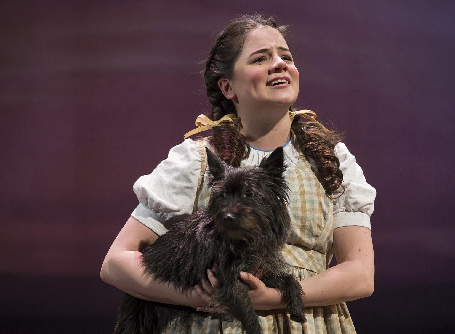 "Elizabeth Stenholt as Dorothy and Nessa as Toto in ""The Wizard of Oz."" (Photo credit: Liz Lauren)"