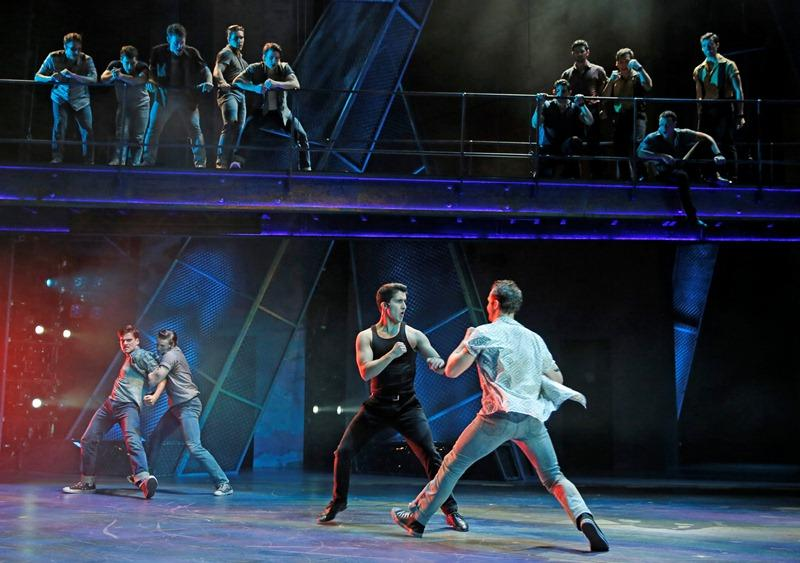 "Tony (Will Skrip) is held back by Diesel (Aaron Patrick Craven) as Bernardo (Alexander Aguilar) takes a swing at Riff (Jeff Smith) in ""West Side Story"". (Liz Lauren)"