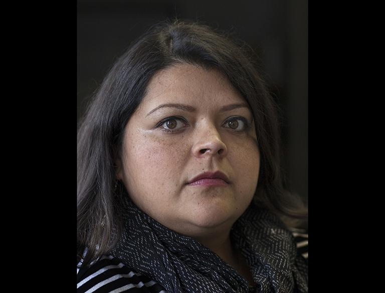 Olga Bautista, secretary of the Southeast Environmental Task Force. Bautista is one of several community activists who protested oil refineries in her neighborhood. (Terry Evans / Courtesy of Museum of Contemporary Photography)