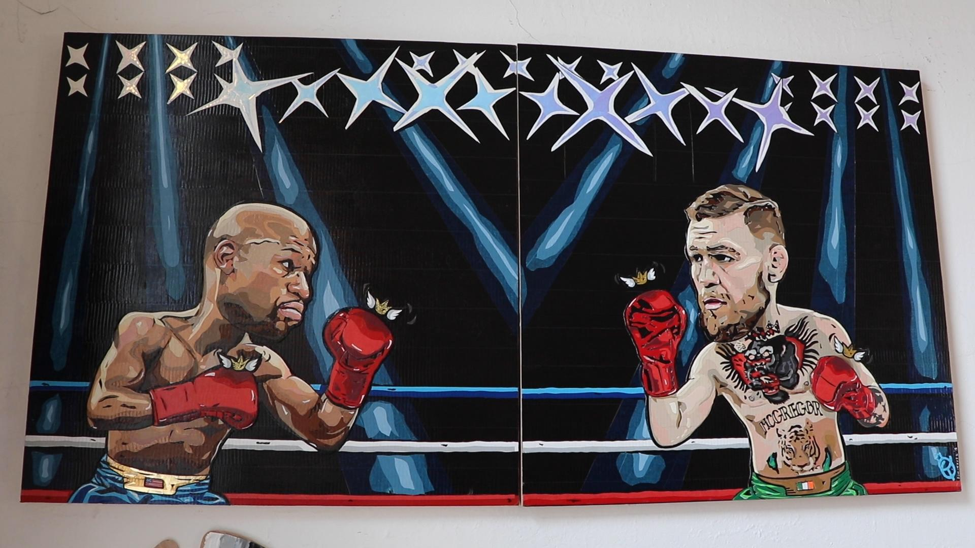 Artist and sports fan Anna Dominguez taped together this depiction of the August 2017 boxing match between Floyd Mayweather Jr. and Conor McGregor. (Evan Garcia / WTTW News)