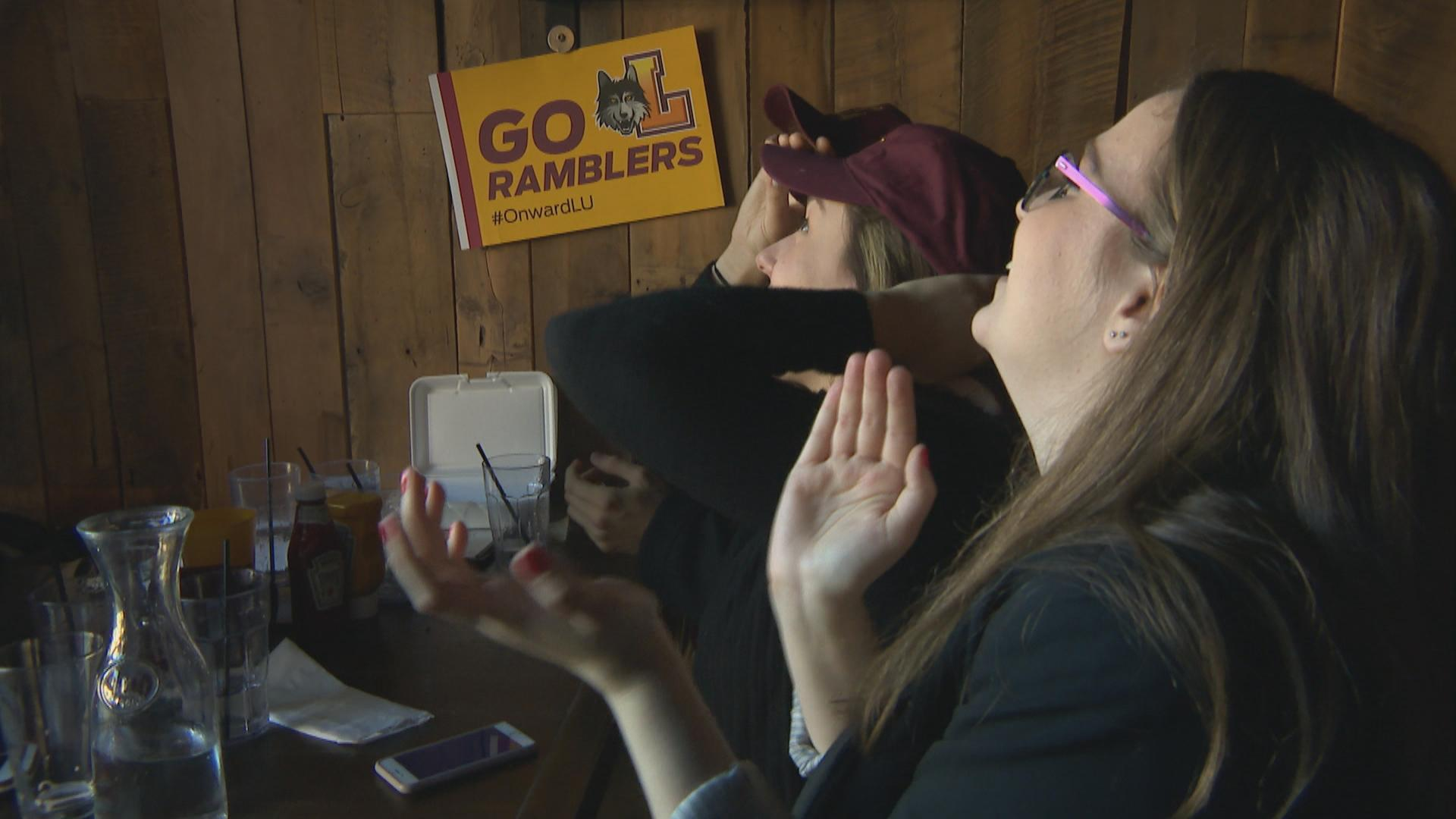 Loyola Ramblers fans cheer on the team at in Rogers Park bar Bruno's on Thursday, March 15, 2018.
