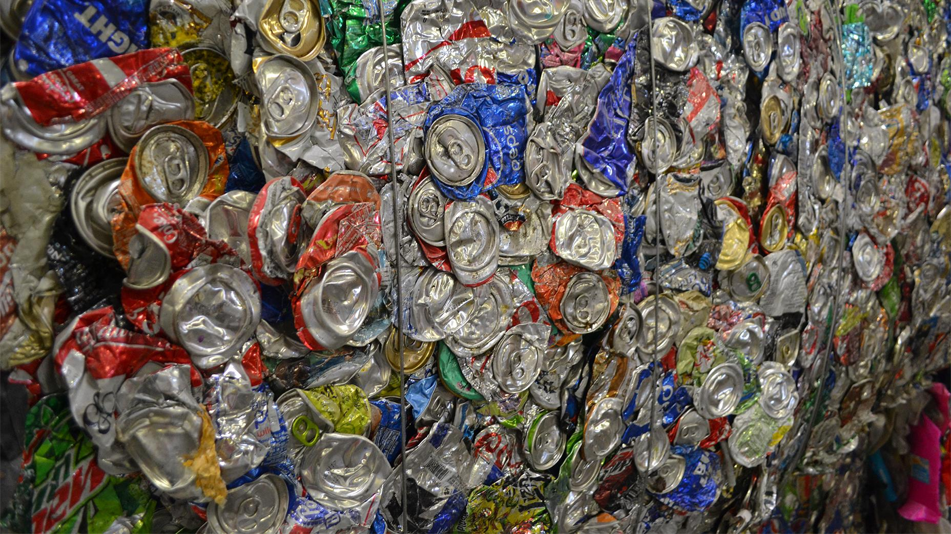 Aluminum cans bundled together in large bales at one of Chicago's recycling facilities wait to be transferred into a container and delivered elsewhere. (Alex Ruppenthal / Chicago Tonight)