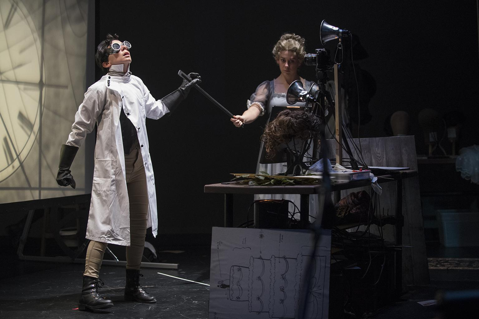 "Sarah Fornace, left, and Julia Miller in ""Frankenstein"" by Manual Cinema at Court Theatre. (Photo by Michael Brosilow)"