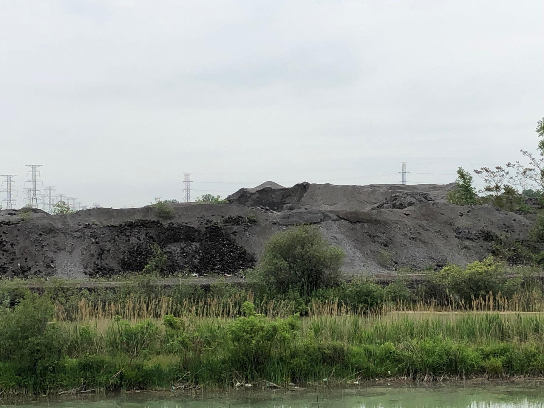 Piles of slag at the 67-acre Southeast Side property formerly used by Republic Steel. (Alex Ruppenthal / WTTW News)