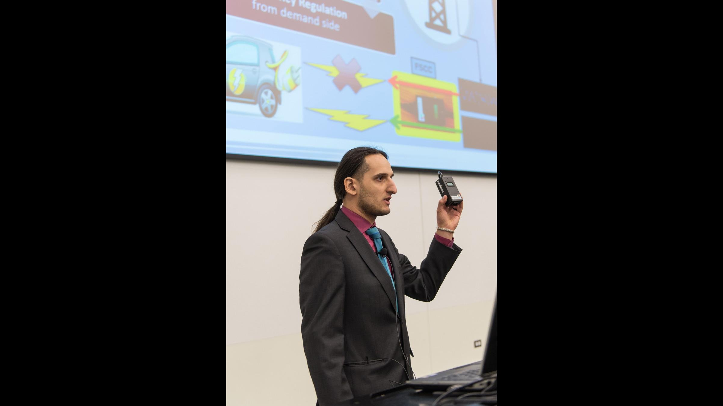 Diego Fazi from Argonne National Laboratory discusses technology at a laboratory pitch competition. He will moderate a pitch competition for innovations arising from work at Argonne on Sept. 14. (Courtesy Argonne National Laboratory)