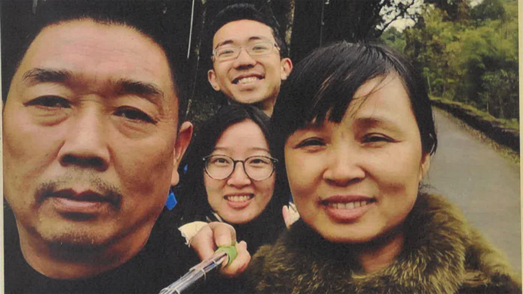Yingying Zhang, center, takes a photo with her father Ronggao Zhang, left, mother Lifeng Ye and fiance Xiaolin Hou. (U.S. Attorney's Office)