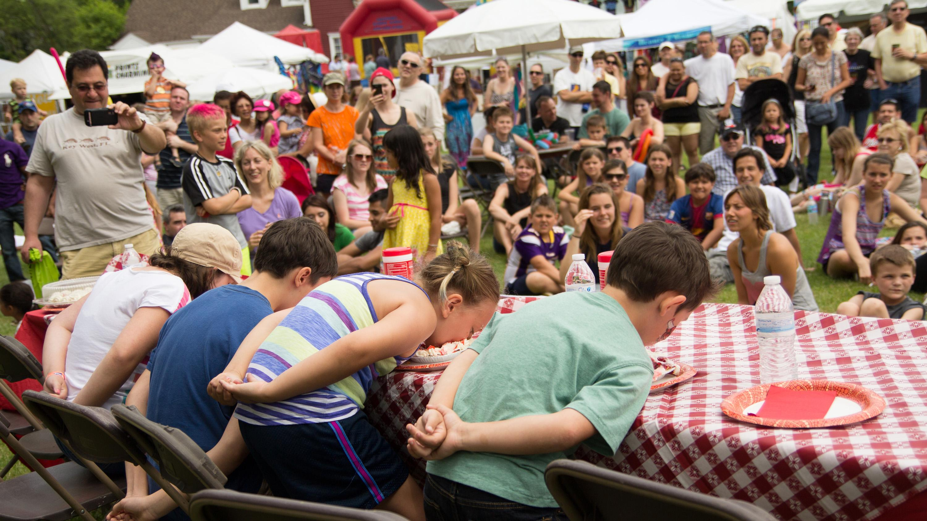 A strawberry pie-eating festival takes place at Strawberry Fest. (Courtesy of Jody Grimaldi)