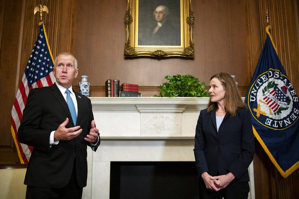 Sen. Thom Tillis, R-N.C., meets with Judge Amy Coney Barrett, President Donald Trump's nominee to the Supreme Court at the U.S. Capitol Wednesday, Sept. 30, 2020, in Washington. (Bill Clark / Pool via AP)