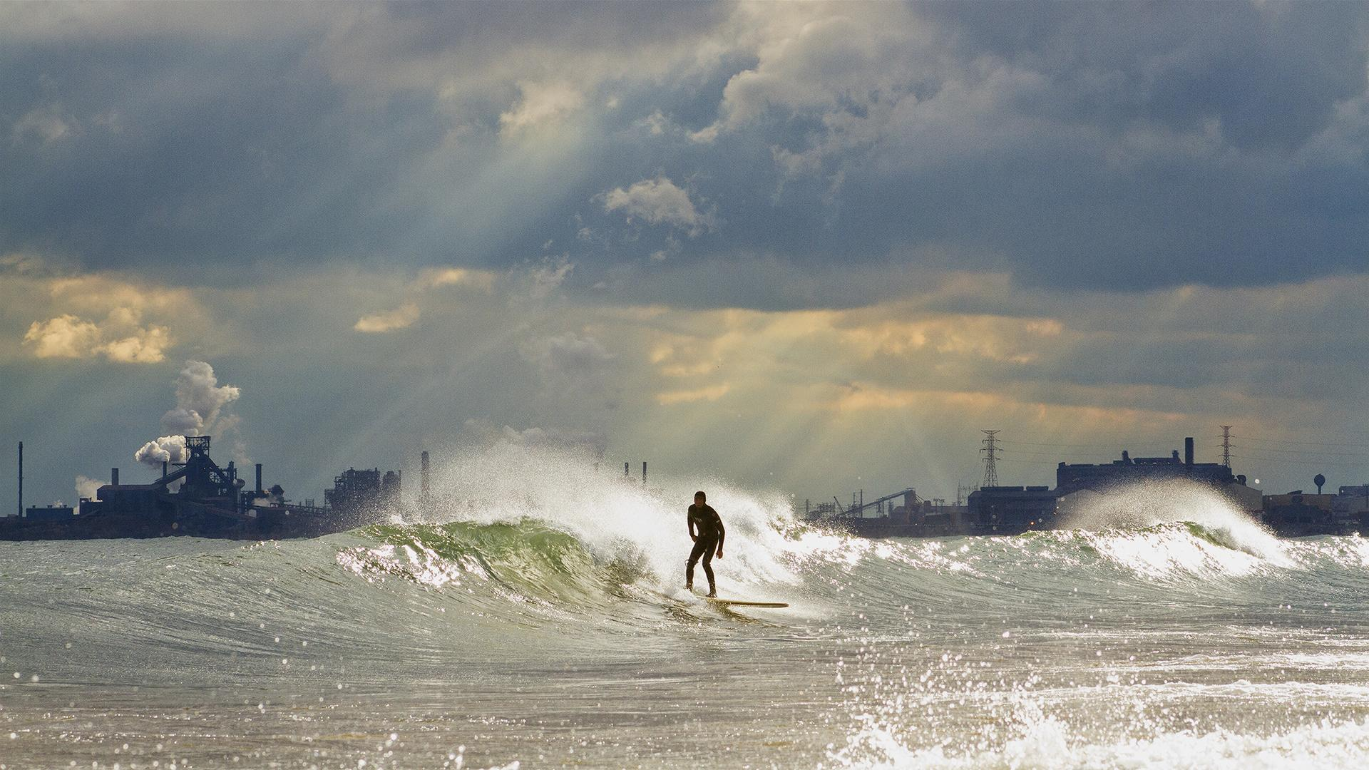 A surfer rides the waves on the south end of Lake Michigan. (Credit: Mike Killion)