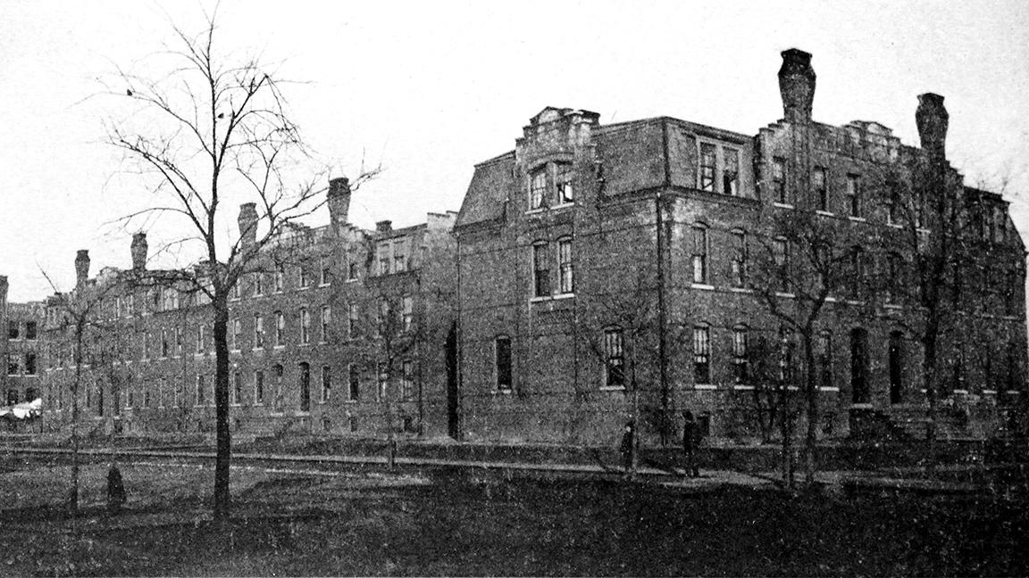 "A historic photo shows the three tenement buildings in Pullman where a new loft development is planned. The middle building was demolished in 1939. (""Pullman: City of Brick,"" H. R. Koopman, 1893)"