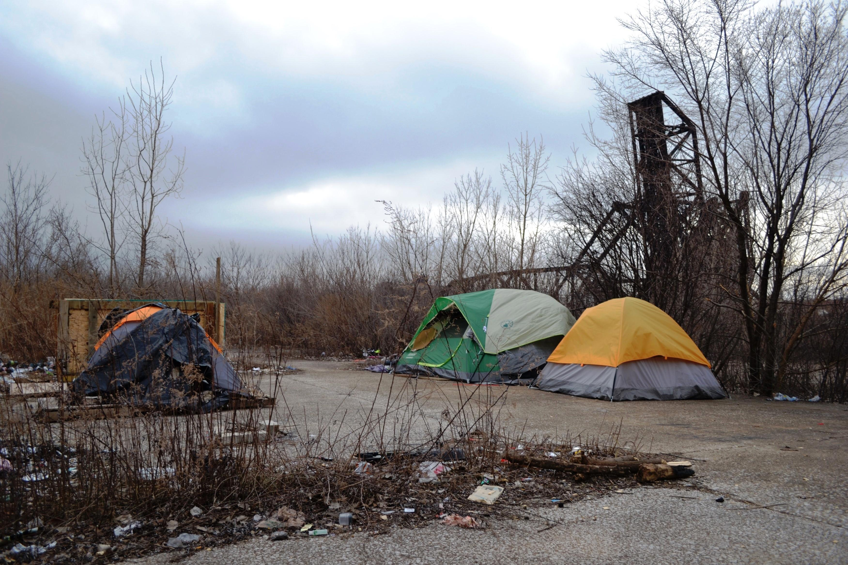 Some sites had signs of recent activity like identification cards neatly placed on a cabinet outside a tent or laundry hanging from a clothes line ... & Exploring a Tent City Along the Chicago River | Chicago Tonight | WTTW