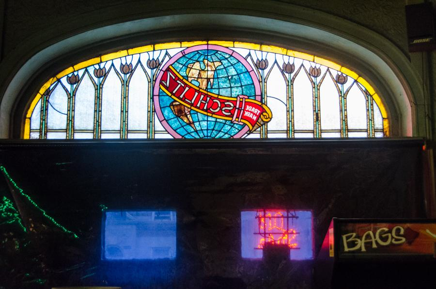 The missing stained glass window as it appeared from inside the bar in recent years. (Courtesy Eric Allix Rogers)